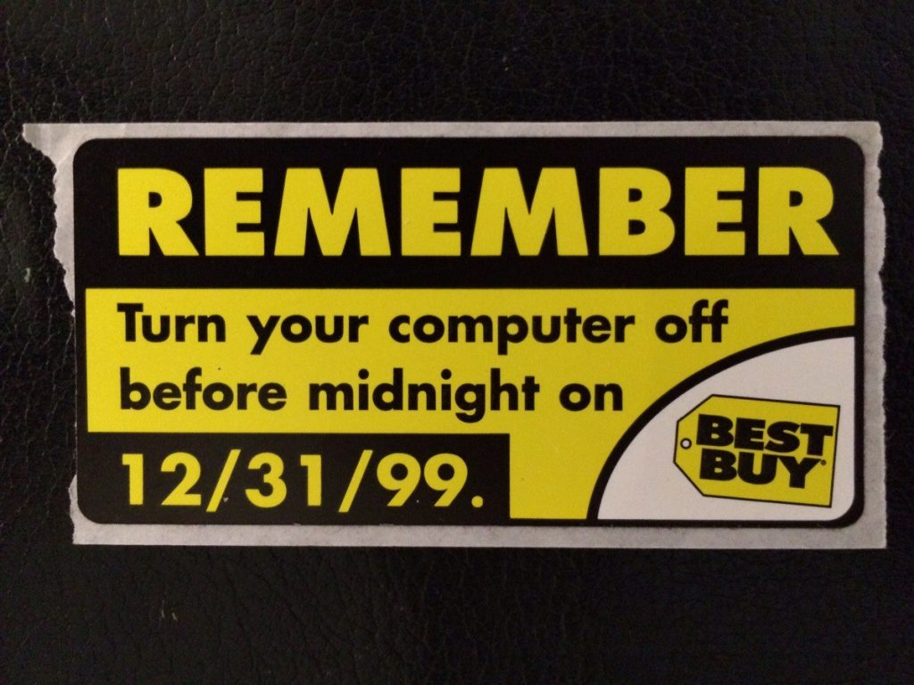 "An old Best Buy tag that says ""REMEMBER: Turn your computer off before midnight on 12/31/99."""